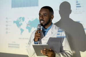 Black doctor giving speech at conference